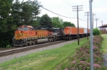 BNSF 5168 leads eastbound by westbound.