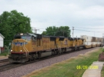 UP 4404 leads stack train towards Global III