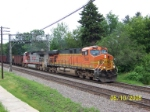 BNSF 7692 leads empty taconite train west.