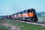 e/b CMSTP&P train led by SD40-2s #3019 + #3007