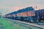 w/b CMSTP&P train led by SD40-2s #194 + #141