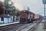 w/b CMSTP&P train led by SD40-2s #174 + 1 more