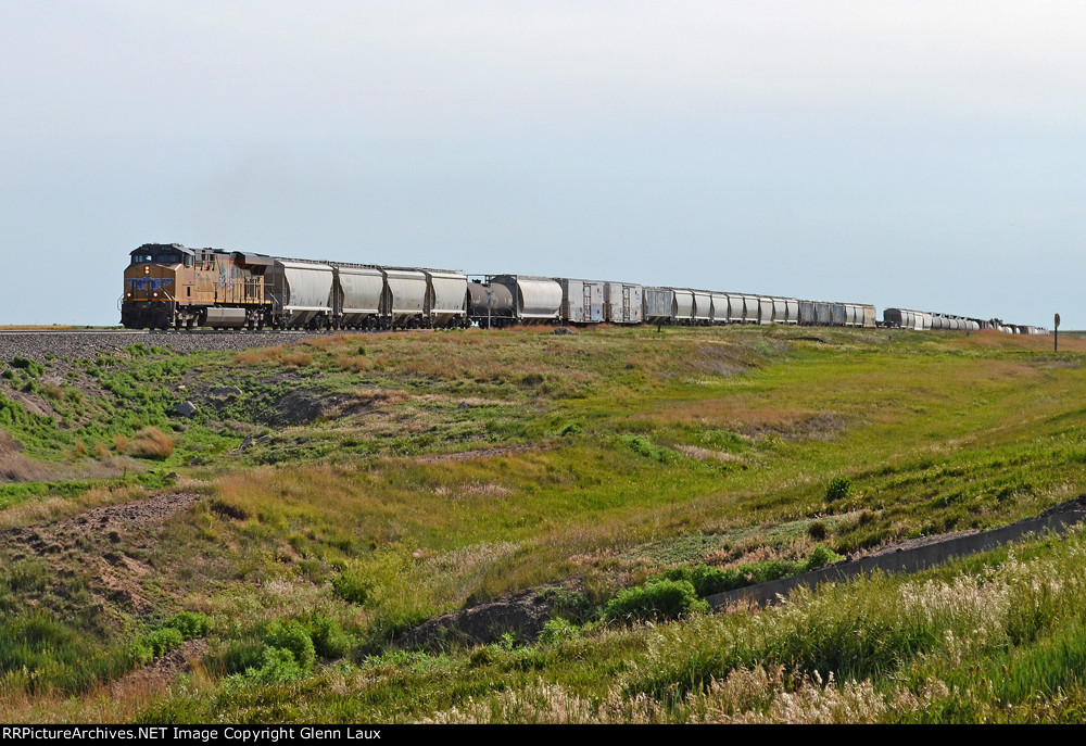 One unit wonder UP 7726 hauling mixed freight westbound