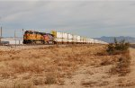 BNSF 5379 and 605 haul a WB stack train
