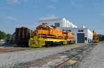Rebuilt GP10 sits out in the sun with a fresh paint job next to a bulkhead flat that contains the long hood of Utah #2006.
