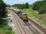 Lone CSX GEVO #5290 pulls a train of covered hoppers off the Jesup Sub