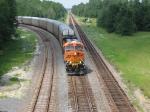 Lone BNSF GEVO #7750 pulls a unit auto-rack train off the Jesup Sub