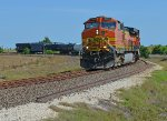 BNSF 4368 and 991 come to a stop with a short train, waiting for a green signal