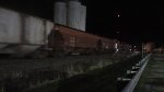 CN 5698 NB A484 Mixedfreight with 3 engines passing the grain elevator in Richmond At Night