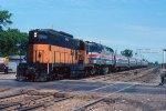 e/b Amtrak led by CMSTP&P GP9 #802 + AMTK F40PHR #237