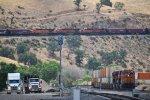 N/B BNSF grain train, S/B stack train, and Trucks