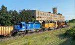 WE 7004 & Co. pass the former Firestone Plant 1.