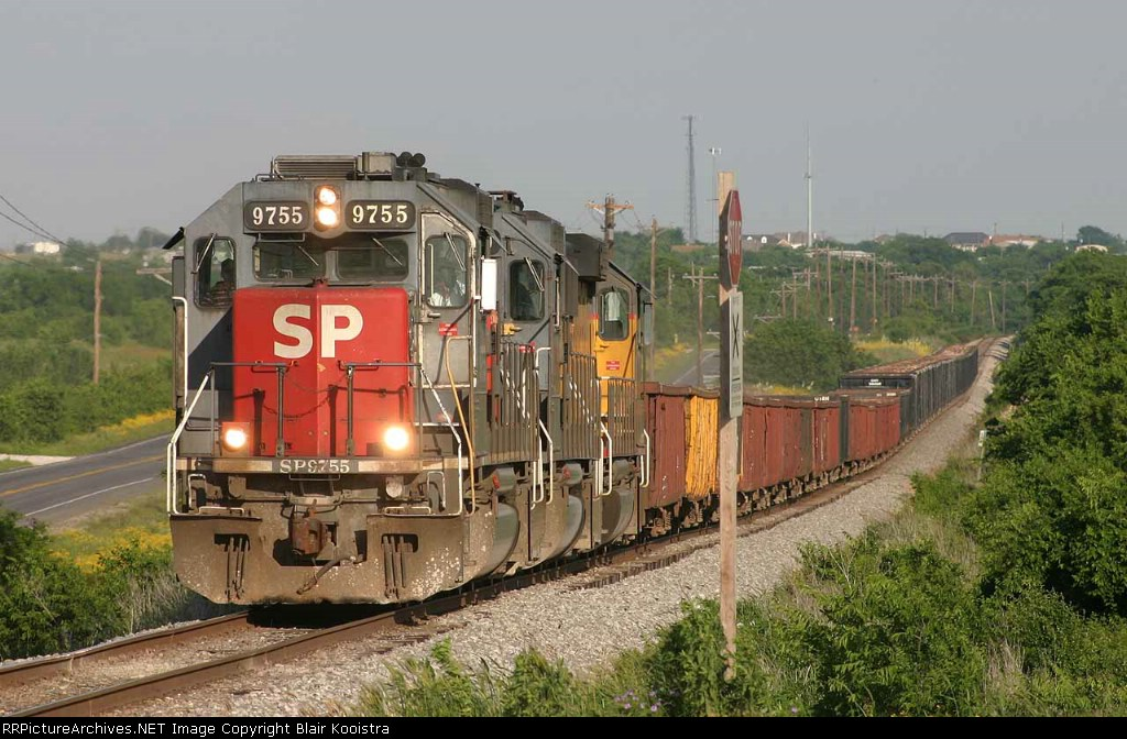 SP 9755 leads northbound Chico rock empty near Newark, TX on Duncan subdivision