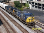 CSX 7864 leads northbound near Amtrak station