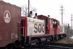 SOO Line SW9s #2118 + #2119 leading e/b train across CMSTP&P