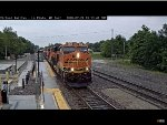 BNSF ES44C4 #8046 Leads a WB Stack in the Rain at La Plata