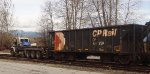 CP 540109, triaxle hi-railer, coupled up to a string of empty hoppers