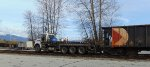 CP 540109 triaxle hi-railer, coupled up to a string of open hoppers
