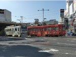 Trams passing