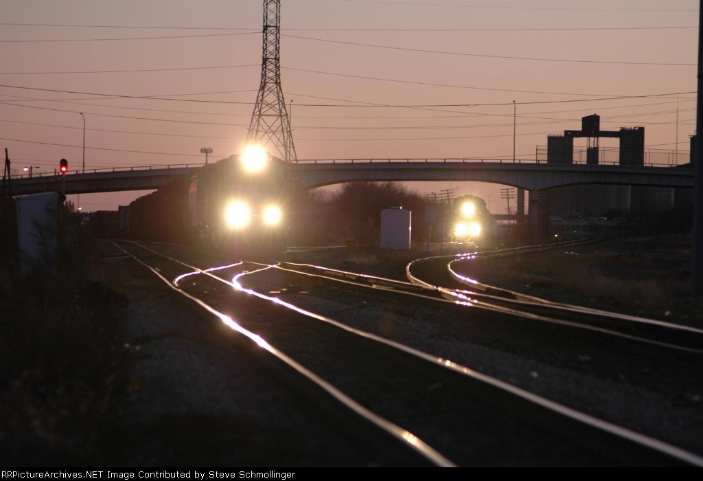 Two northbound UP freights at dusk at Tower 55
