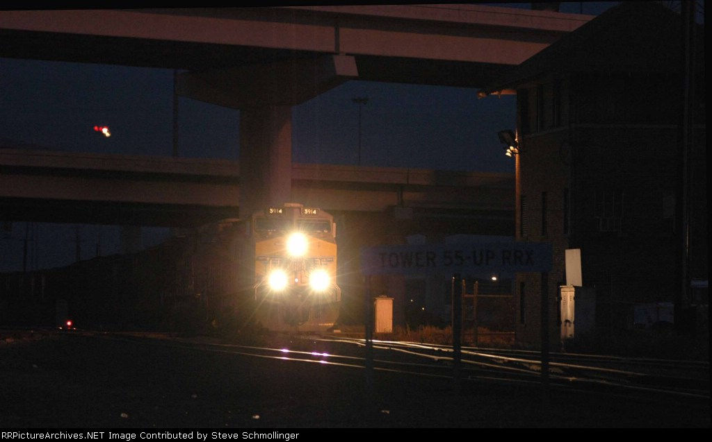 UP 5914 South illuminated by lights of Tower 55