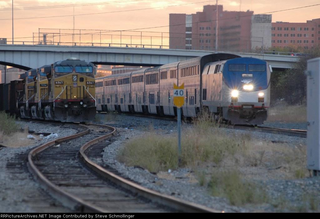 Amtrak No. 21 passes UP coal train parked at Tower 55
