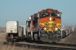BNSF 4835 East prepares to depart after meeting intermodal train
