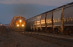 BNSF 4935 South meets empty grain train in the siding at sunset