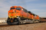 BNSF 5875 West departs town with an empty coal train