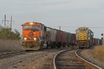BNSF 9297 passes a pair of KCS GP38s idling in the wye