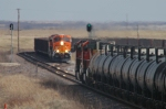 BNSF empty coal train meets eastbound molten sulfur train