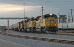 UP 8446 East, a hot Z train, departs Centennial Yard