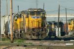 UP 9077 East departs Centennial Yard