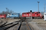 Crossing over the soo with a former Detroit Edison unit in the consist