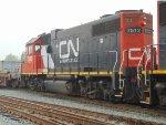 CN 7512, 4th power unit of an E/B stack car train, entering Thorton Yard