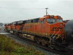 BNSF 8330/6121/6160 E/B with mixed freight consist, stopped at the western entrance to Thorton Yard.