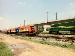 FTVM 9162 pass in front of Metro consist