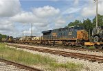 Passing GP38-2 2785 laying over, CSX 3018 pushes midtrain with an Army special