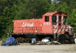 CP 8153 sitting on ancient freight car trucks
