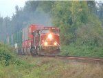 CP 8113/8515 E/B unit stack train approaching the Chester Street crossing just west of Mission, B.C.