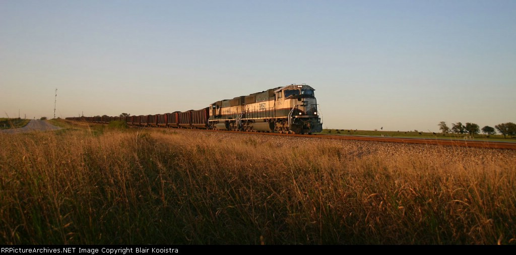 Wide Open Spaces: BNSF 9782 leads an eastbound coal train into Rhome, Texas, in the last rays of the day.