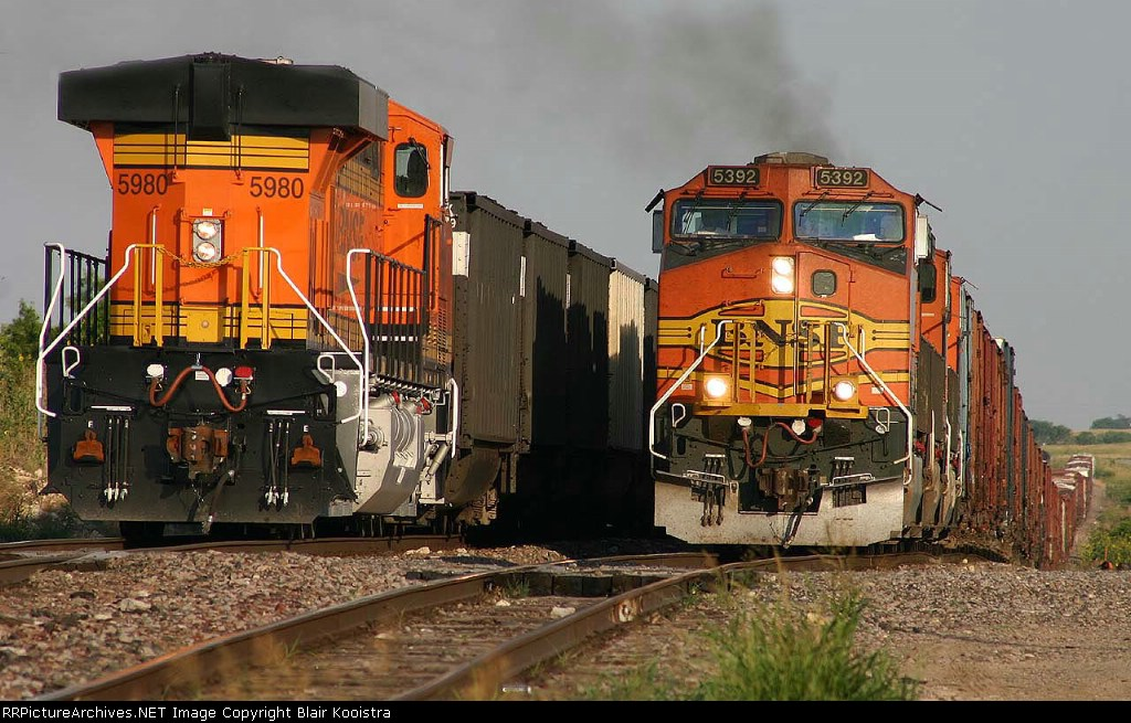 BNSF 5392 leads HALTBAR128 west through the siding at Herman, TX, passing eastbound coal train bound for Sulphur, Lousiana. The ALTBAR is  heavy with paper products, wallboard, and veneer, bound for reclassifying at Barstow, CA