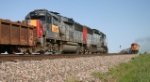 UP's Wichita Falls-Fort Worth local hold the main meeting a westbound BNSF intermodal train at Herman, Texas