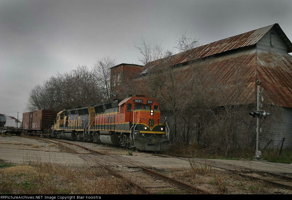BNSF 3031/3037 pick up a bad order car at Caldwell, TX working back on the Somerville-Temple local