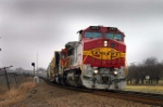 BNSF 869 leads an eastbound through the reverse curves at West Rogers, TX