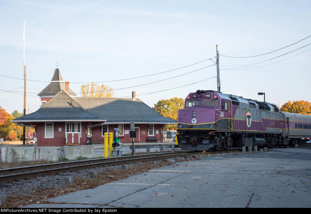 MBTA 1068 poses with the Walpole Station