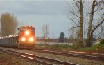 W/B CN mixed freight consist led by CN 2842, approaching Gladwin crossing