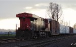 W/B mixed freight consist with trailing DPU, CN 3805 west of Gladwin crossing