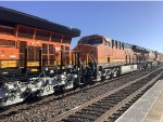 Another Fresh BNSF ET44C4 Trails a WB Ballast Train at Commerce