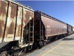 A Standard BNSF Hopper Passes Commerce